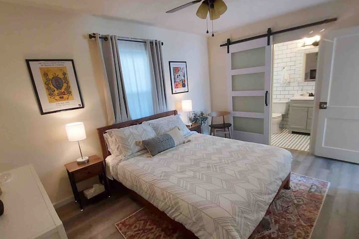 Cozy and quiet bedroom with queen size bed and blackout curtain. Lamps have USB ports.