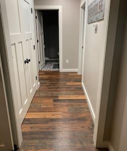 Hallway to main bath, bedroom 1 and 2.