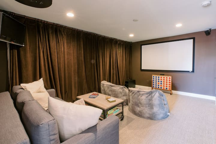 Movie room with pull out sofa bed and full bathroom