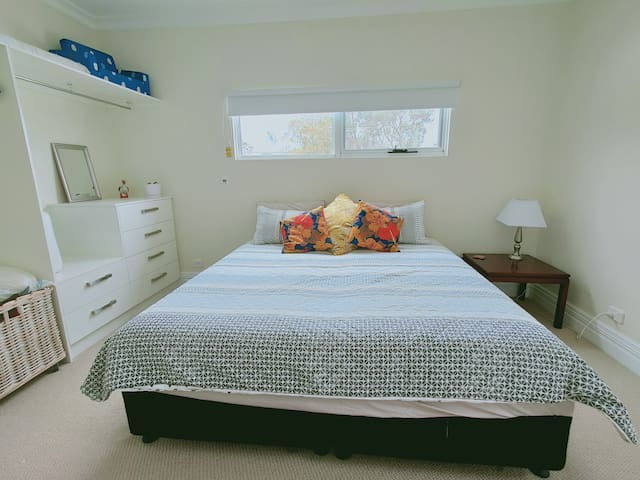 Bedroom set up with the king bed.