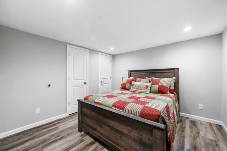 Queen bedroom downstairs with a HUGE walk in closet!