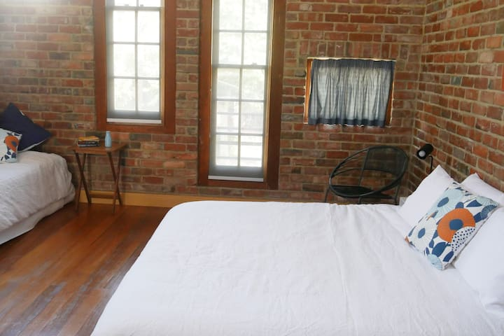 BEDROOM TWO: The upstairs bedroom with tree canopy outlook has a king and single bed.