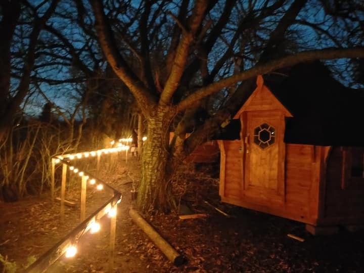 Romantic night or two in a cosy Hobbit Hut.