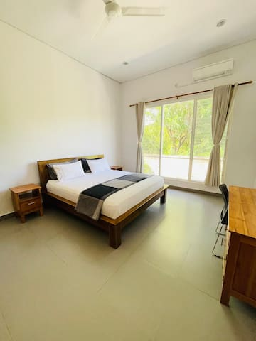 Bedroom 1 in Villa #3. Very spacious with an excellent view of the pool and deck area. All bedrooms have AirCon and ceiling fans for your comfort