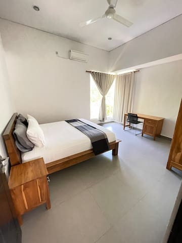 Bedroom 2 in Villa #3. Extra Large King Size bed. AirCon and ceiling fans are in all bedrooms.