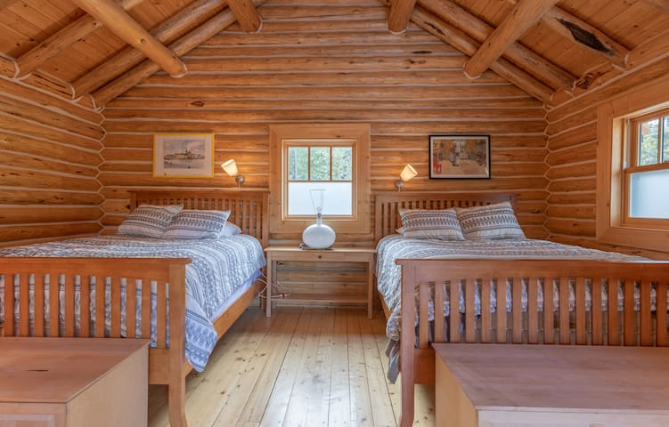 Upper level bedroom has 2 queen beds.