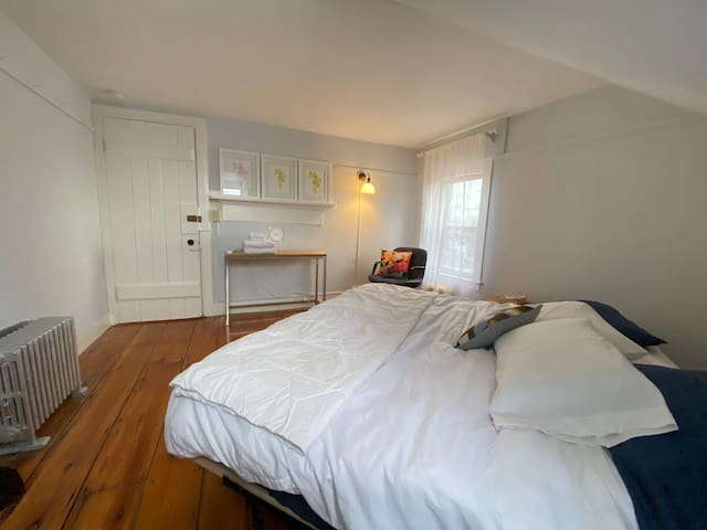 Serene, uncluttered, private master bedroom at the southeast end of the loft space.