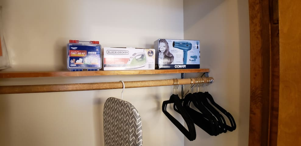 Iron board, Iron, hair dryer, and firstaid kit