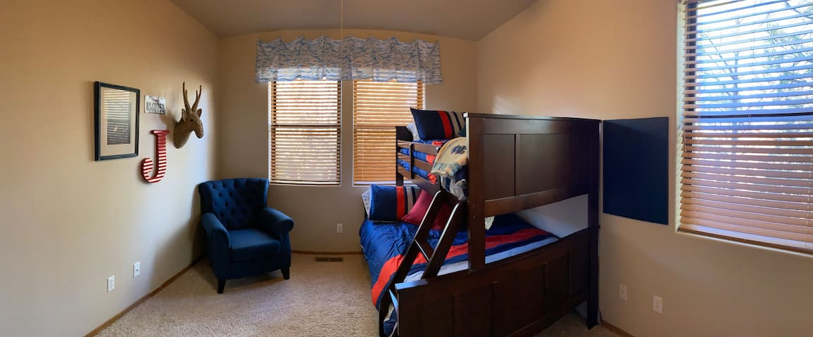 J Bedroom has a double bottom and twin top. Fan and closet complete this room.