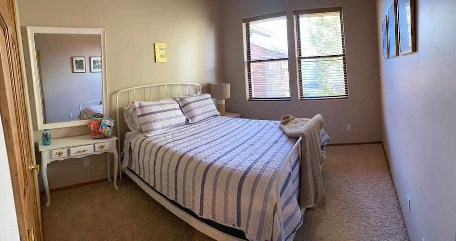 E bedroom offers queen size comfort, closet and fan.