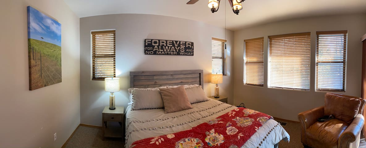 Master bedroom has a king size bed, smart tv, full bathroom within and deck access.