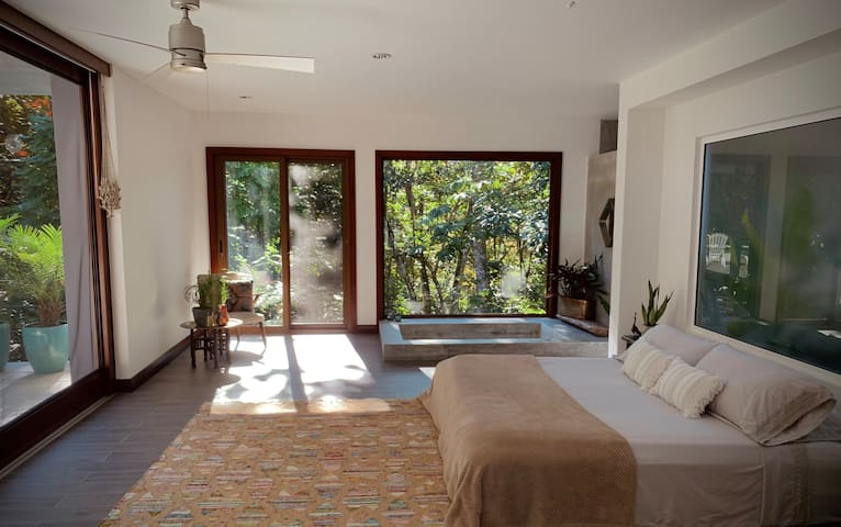 Morning sunshine filters through the forest and fills the master bedroom