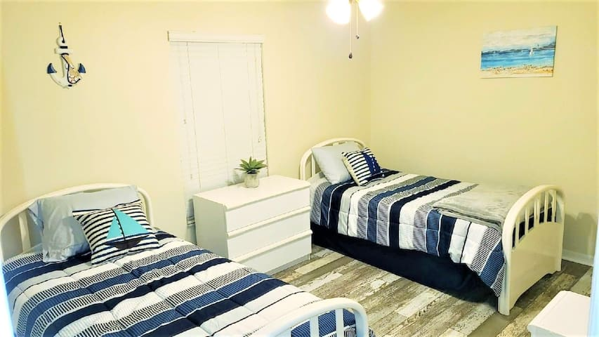 Twin bed and one trundle bed