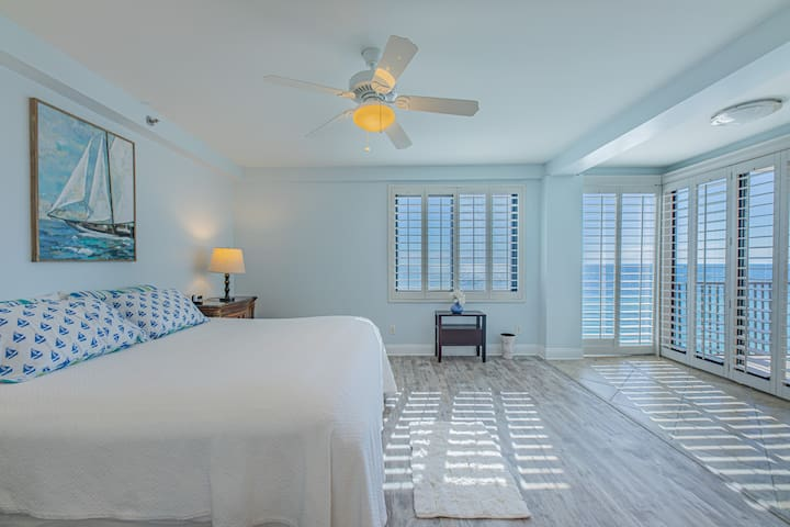 Spacious Master suite with balcony access overlooking the white sandy beach, evening sunsets and the Gulf of Mexico.