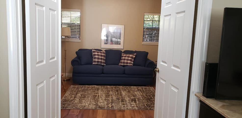 Second bedroom has a queen size  sofa bed, a smaller closet, dresser and a work desk.