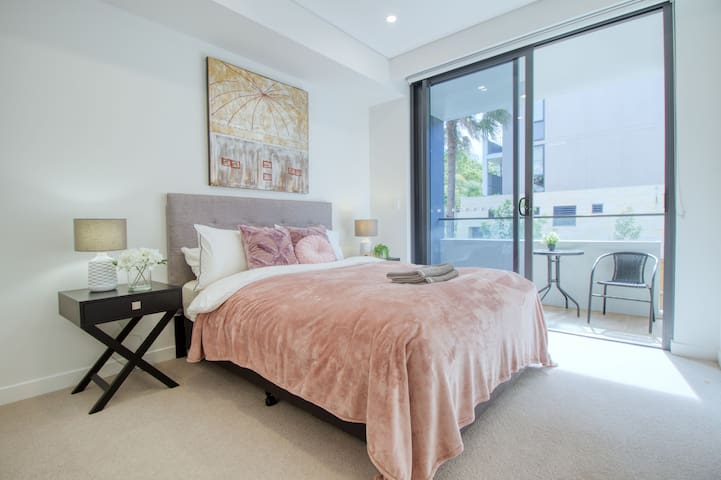 Master bedroom with private en-suite, private balcony and large closet.