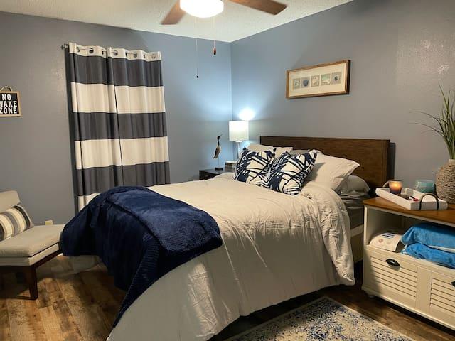 Queen bed in bedroom.  Brand new comforter, sheets, rug, and mattress pad.