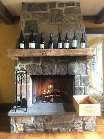 The main room's hearth pairs well with a good bottle (or a few) of wine.