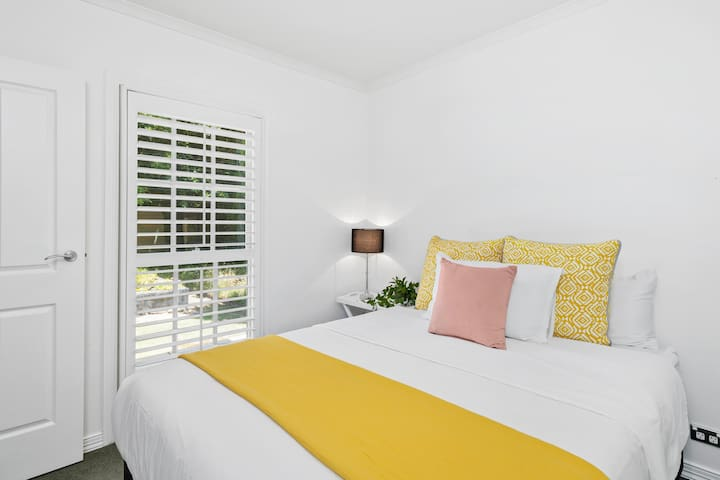 Queen bedroom made up with hotel quality sheets and bath towels.