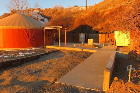 No step sidewalk at driveway,  no steps to yurt entrance.