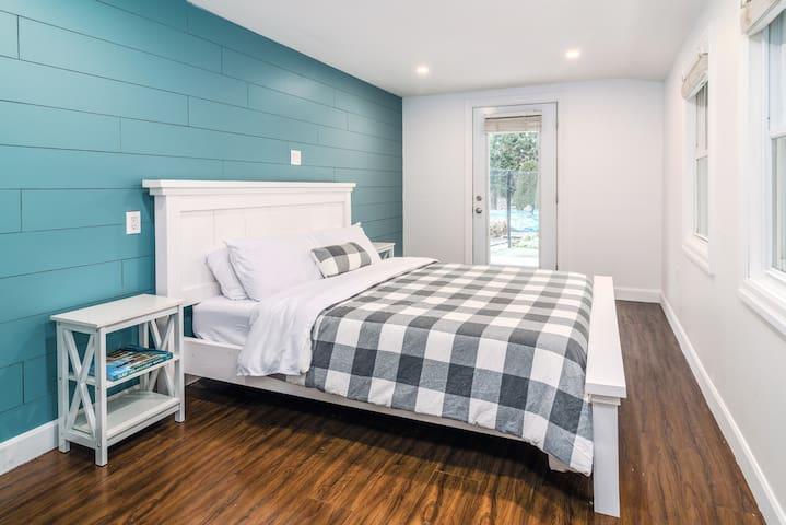 Second bedroom - main floor. With a queen bed