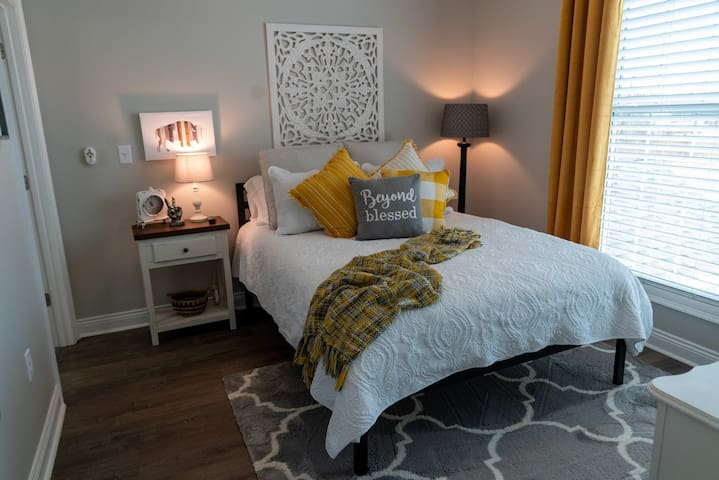 The guest room is peaceful and comfortable with a queen sized bed.