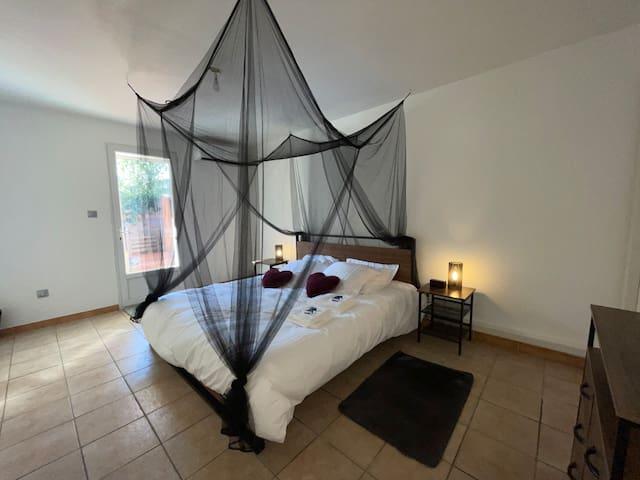 Chambre avec un lit de 180x200
