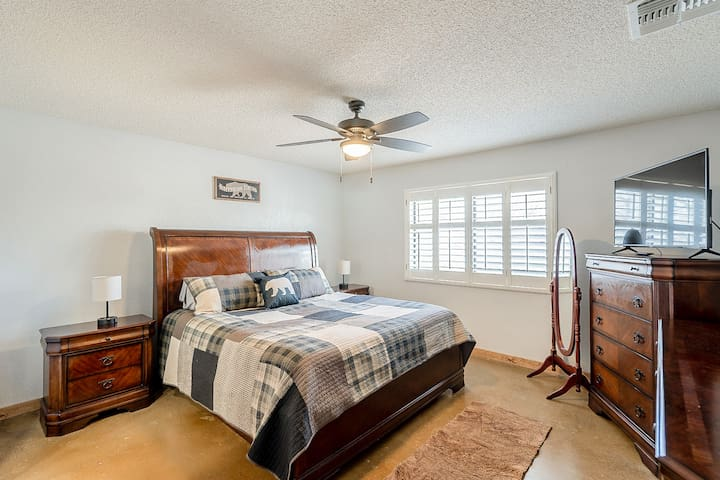 Beautifully appointed master bedroom with King bed, floor length mirror and smart TV