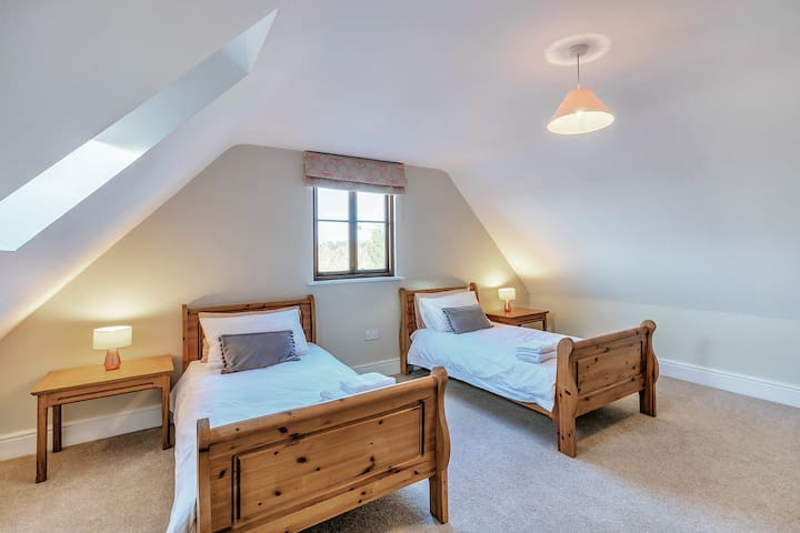 Bedroom 5  Twin beds with built in storage cupboard for clothes & luggage and adjacent to a shared bathroom