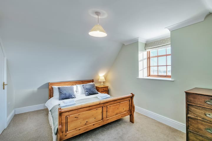 Bedroom 4  Double bed with built in storage cupboard for clothes & luggage and adjacent to a shared bathroom