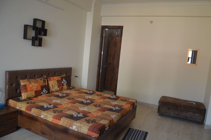 Cozy Bedroom with Mirror, (3+ 2 )Seater Sofa bed,Walk in dresser, Wardrob with Tv, cable connection,WIFI Broadband
