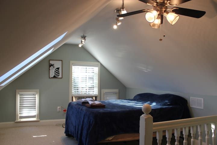 Third bedroom is accessed via the master suite. This wonderful attic bedroom has two sky lights opposite the bed and the slanted ceilings making you feel a bit like you are a kid again having your own secret hideaway. Or for the kids.