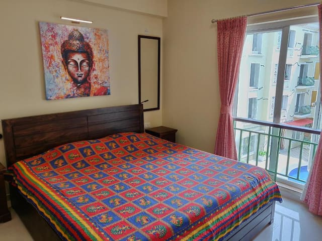 Master bedroom with a King Size Double bed, overlooking the pool