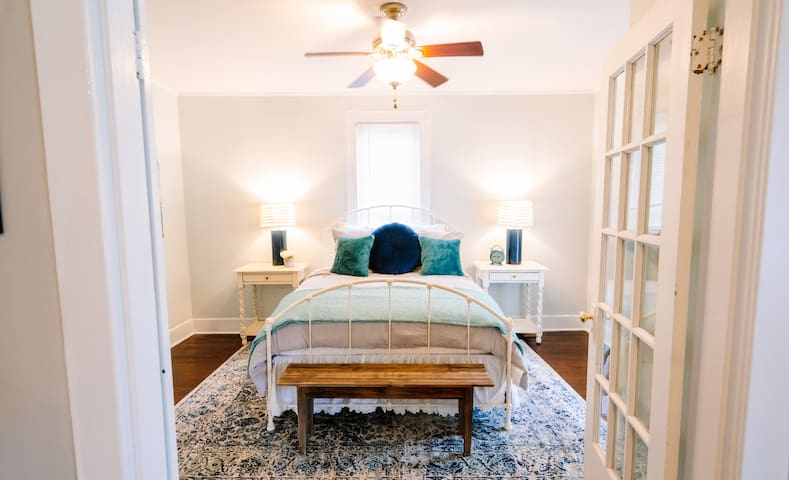 Spacious Master Bedroom inside french doors. Queen size bed. Blackout roman shades  are on the french doors.