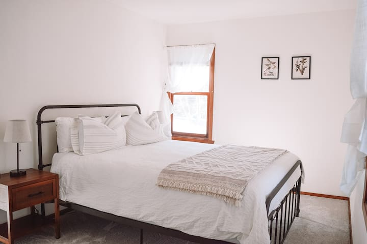 """Master Bedroom    Queen bed with soft new bed linens (100% cotton or linen, always, flannel in winter) and pure green natural latex mattress locally made in Chicago.  As one recent guest noted, """"The bed mattresses are incredible!"""" -Jay, Feb2021"""