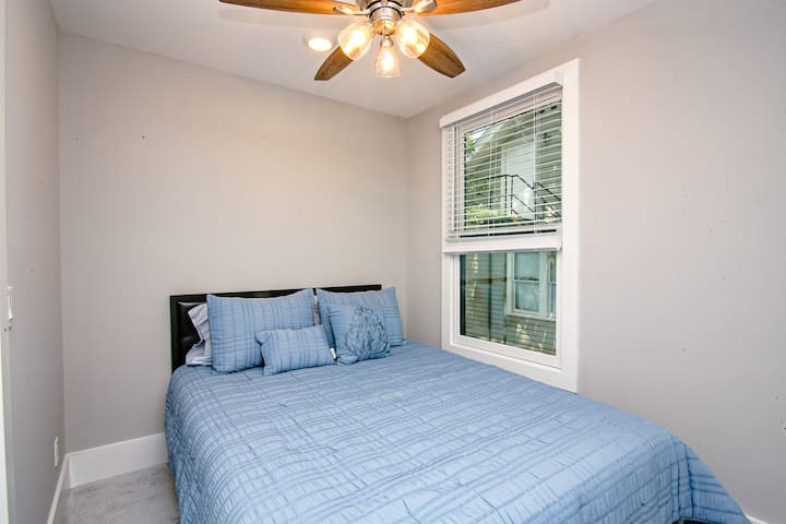 The queen size bedroom is quaint and cozy - perfect for a traveling single or couple!