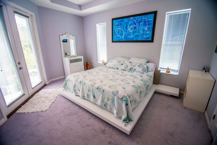 King bed in the Master bedroom  (same Master bedroom as other picture but sheets and art work are different).