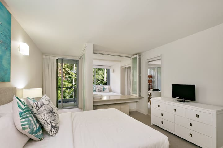 Rest well in the master bedroom with a queen bed, TV, ensuite and access to a second balcony.