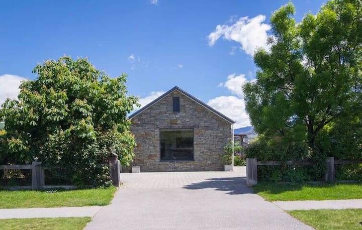 Sweet cottage in sunny garden
