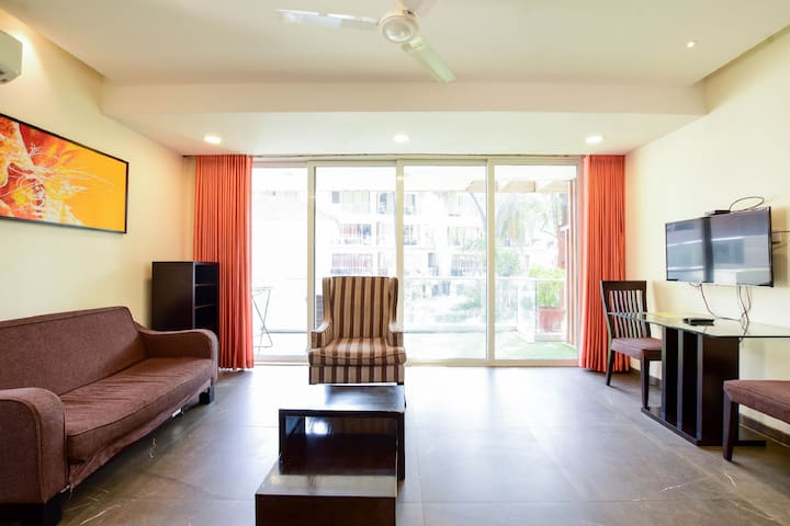 Hall room - Air conditioned, furnished with sofa set with center table, Dining Table with chairs and LED TV with Satellite Live