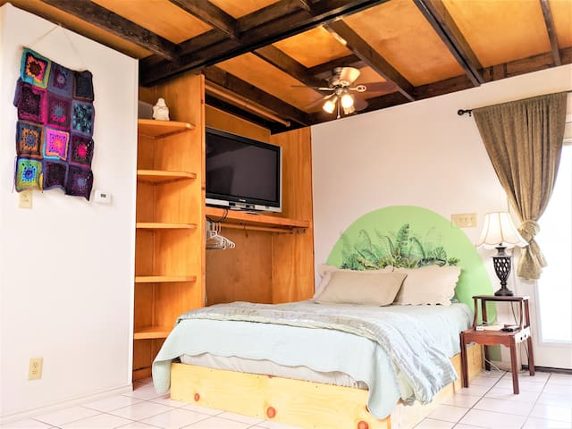 Although the condo has an open studio floorplan, guests can use folding screens to section off the queen size bed and handmade shelving + hanging closet. Allowing guests to a conveniently store their clothes right by their sleeping area.