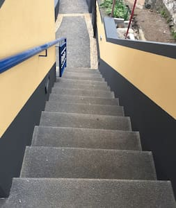 There are easy steps with a hand rail