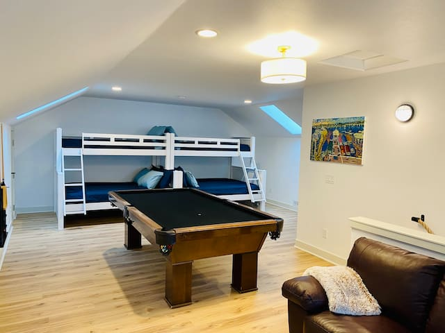 Upstairs bedroom with two bunk beds (Twin XL over Queen) and pool table.