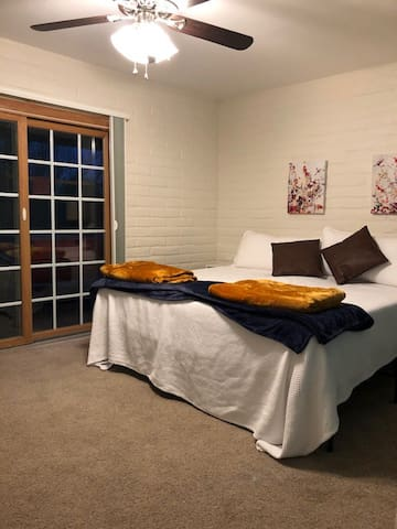 Bedroom with king sized bed.  Sliding door access to front patio area.