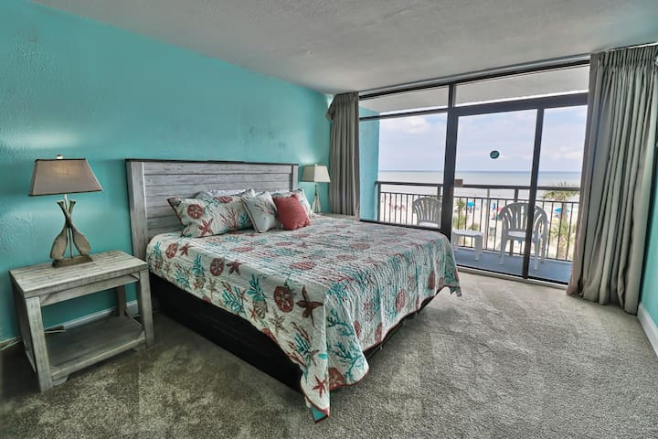 You truly can enjoy watching the waves from this king size bed.