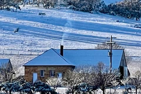 Old farm stone barn at foothills of Snowy Mts.