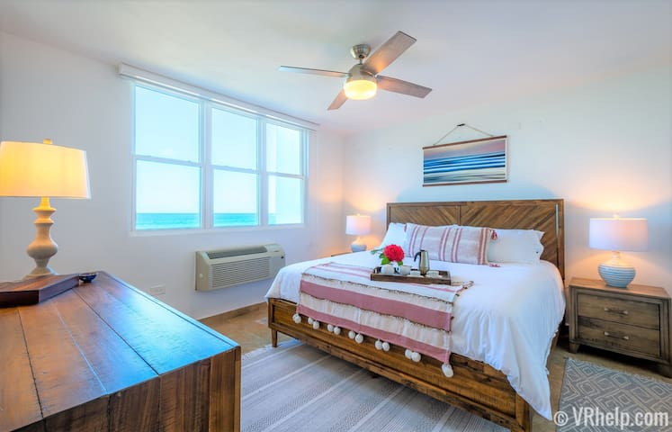 Unit Overview #2: the master bedroom, with king bed, en suite bath, and endless ocean views.