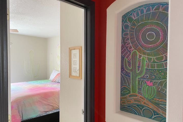 Soothing and Artsy Chalk art welcomes you to the the main bedroom - with an oh-so-comfy bed.