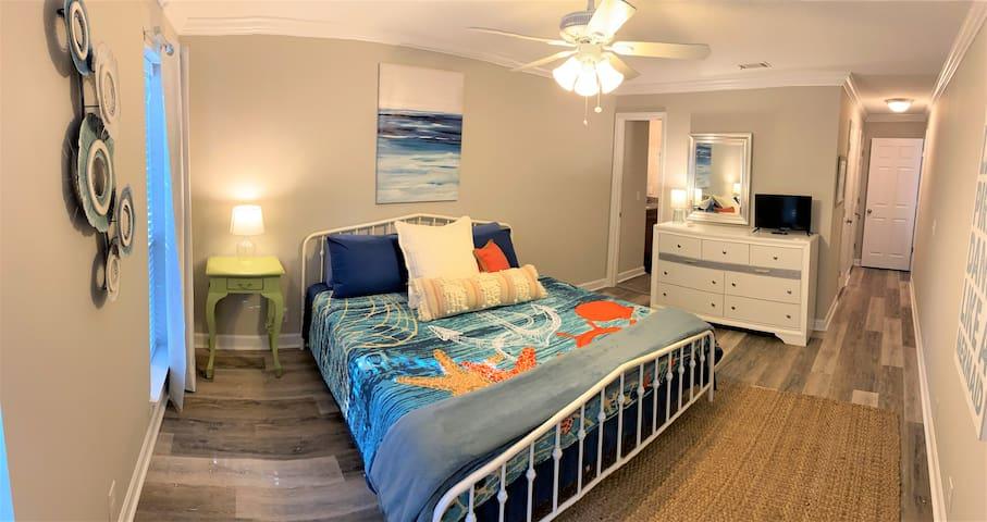 Bedroom 1 features a comfy King bed & ensuite bath.