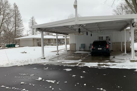 Two Car carport, access straight into kitchen side door to avoid steps.